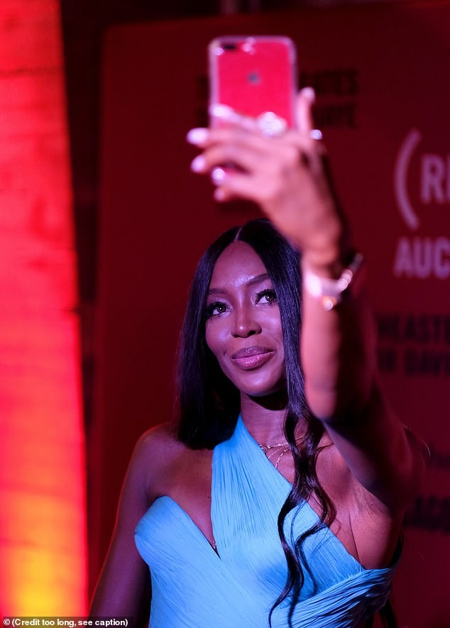 Naomi Campbell dazzles in electric blue gown as she attends an event in Maimi (Photos)