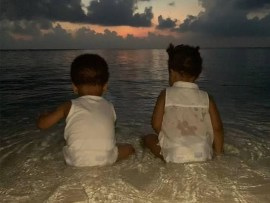 Beyonce shares rare photos of her twins Sir and Rumi playing at the beach during their trip to India (Photos)