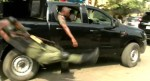 Video: Police Officer Falls From Moving Van And Get Injured
