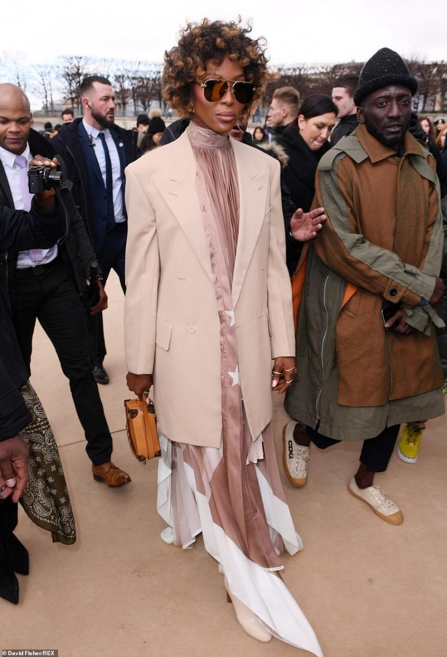 Naomi Campbell suffers wardrobe malfunction as she exposes her underwear at Louis Vuitton