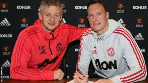 Manchester United interim manager Ole Gunnar Solskjaer and defender Phil Jones