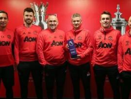 Man Utd manager Ole Gunnar Solskjaer (third from right) and his coaching team