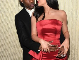 Kylie Jenner & Travis Scott pack on the PDA at Clive Davis pre-Grammy