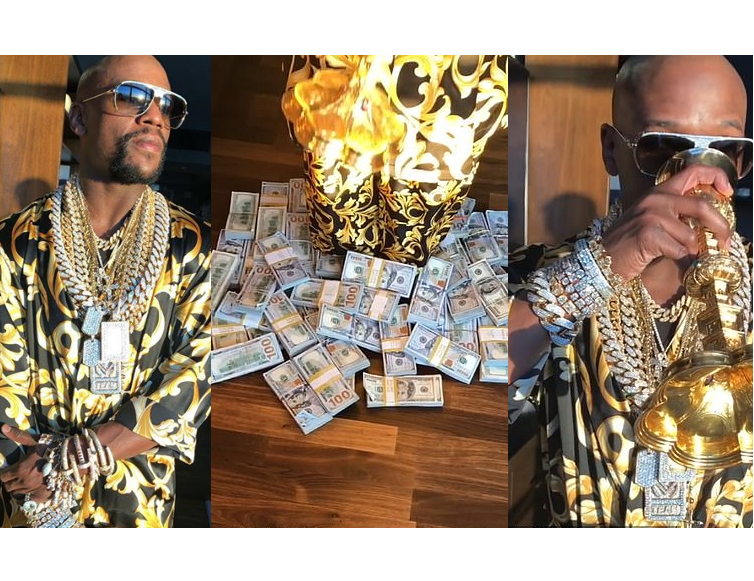 Floyd Mayweather flaunts lavish lifestyle with piles of cash and diamond jewellery as he sips from a gold goblet (Video)