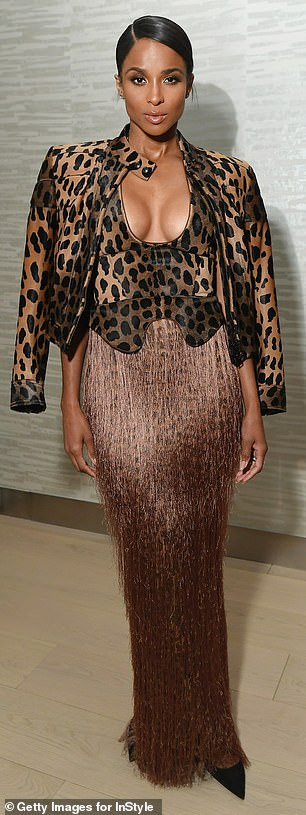 Ciara flaunts cleavage in plunging animal print ensemble as she attends InStyle Dinner with her husband  (Photos)