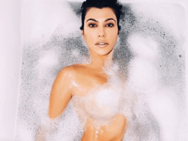 Followers unimpressed as Kourtney Kardashian shares naked photo of herself soaking in a tub