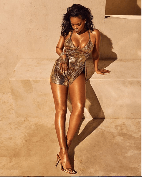 Rihanna shares more glowing photos of herself posing in a tiny golden mini dress?