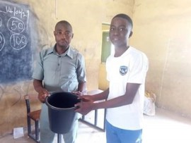 Photos: Student teachers gifted plastic buckets by Headmaster during their sendforth in Abuja