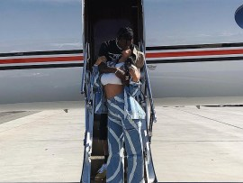 Kylie Jenner and Travis Scott share a sweet kiss as they take a private jet to Coachella (Photo)