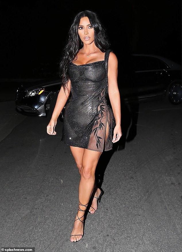 Kim Kardashian showcases her curves in sheer vintage Versace mini dress for Kourtney