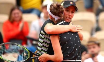 Johanna Konta embraces Marketa Vondrousova after the defeat