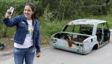 A visitor to Chernobyl takes a selfie