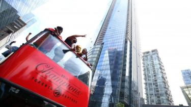 Drake and Kyle Lowry #7 of the Toronto Raptors holds the championship trophy during the Toronto Raptors Victory Parade on June 17, 2019 in Toronto, Canada