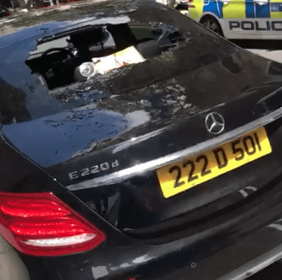 Video: Nigerian man goes on rampage, destroys cars at Nigerian High Commission in the UK after officials failed to act on his request