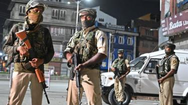 Indian paramilitary troopers stand guard at a roadblock at Maisuma locality in Srinagar on August 4, 2019.