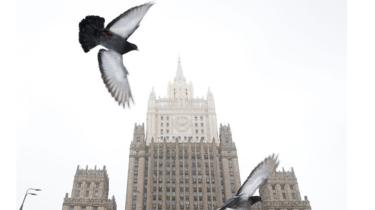 Pigeons fly in front of the Russian Foreign Ministry headquarters in Moscow on March 27, 2018.