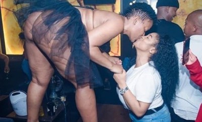 Zodwa Wabantu shows off her bare bum as she bends to kiss female fan on stage