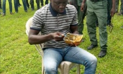 Nigerians react as suspected Port Harcourt serial killer is seen having rice and water while being paraded