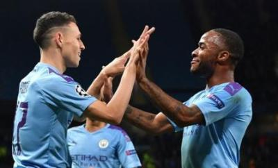 Manchester City's Phil Foden (left) and Raheem Sterling both scored for City in the win over Dinamo Zagreb