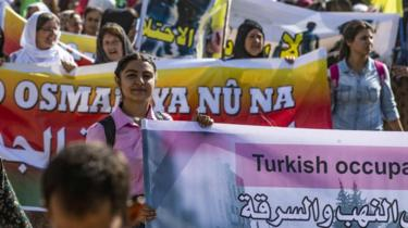 Syrian Kurdish women protest against Turkey's plans for a military operation, in the town of Qahtaniya, Syria (7 October 2019)