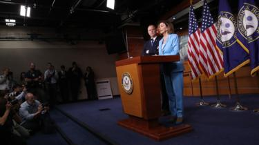 Speaker of the House Nancy Pelosi answers questions with Adam Schiff