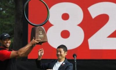 Woods moved on to a record-equalling 82 PGA Tour wins with victory in Japan