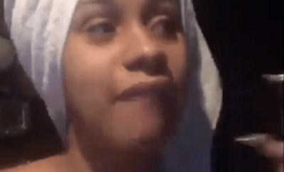 "Cardi B drags follower who called her a ""dumb bitch"" for saying she identifies as a black woman"