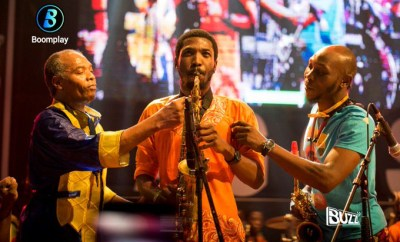 Epic photo of Femi Kuti performing on stage with his son, Made Kuti and his brother, Seun Kuti at Felabration