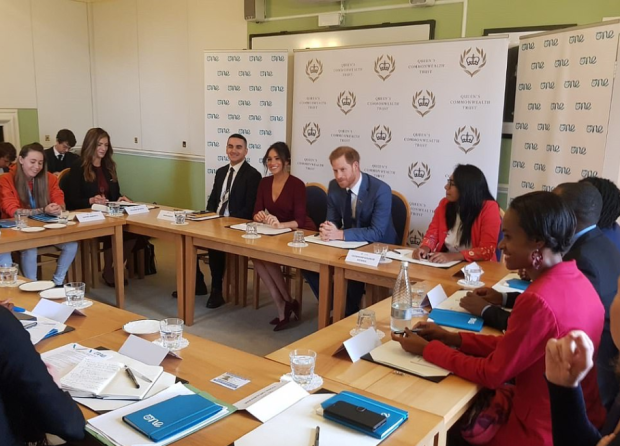 Prince Harry makes a surprise appearance to support Meghan Markle at a round table discussion on gender equity and inclusion (photos)