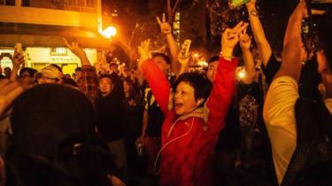 Hong Konger celebrating on election night
