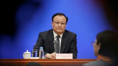 Shohrat Zakir, deputy secretary of the Communist Party committee for China's Xinjiang and chairman of the Xinjiang Uighur Autonomous Region, attends a news conference in Beijing