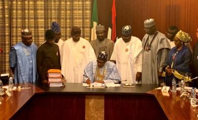 Photos: President Buhari signs 2020 budget into law