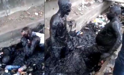 Lol!  Two men engage in serious fight inside a gutter over N100 (video)