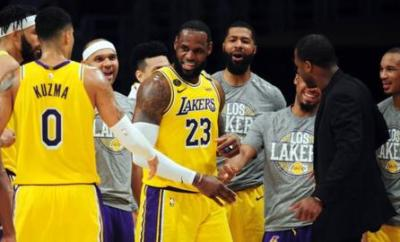 LeBron James surrounded by LA Lakers team-mates