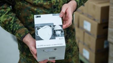 A German soldier unpacks boxes of FFP2 quality masks on 1 April, 2020