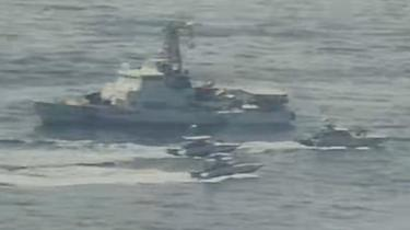 Handout photo from US Navy showing Iranian Islamic Revolutionary Guard Corps Navy (IRGCN) vessels near US vessel in the Gulf (15 April 2020)