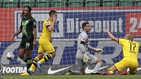 Raphael Guerreiro celebrates scoring for Dortmund