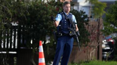 An armed officer at the scene of the shooting