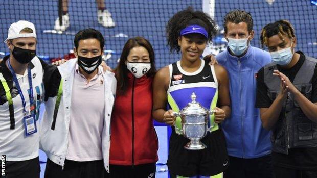 Naomi Osaka celebrates her second US Open win with her team and boyfriend Cordae (on the far right)