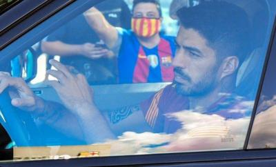 Luis Suarez arrives for training with Barcelona