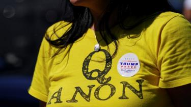 A supporter of US President Donald Trump wears a QAnon shirt after participating in a caravan convoy circuit in Adairsville, Georgia, 5 September 2020