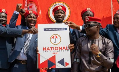 Ugandan singer turned politician Robert Kyagulanyi (C) aka Bobi Wine announces the membership of his new political party called National Unity Platform (NUP)