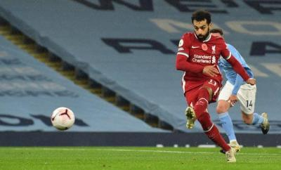 Liverpool forward Mohamed Salah scores a penalty during a 1-1 draw with Manchester City