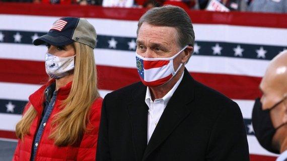 Republican Senators David Perdue and Kelly Loeffler look on ahead of U.S. President Donald Trump hosting a campaign event
