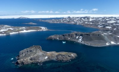 : Aerial view from Chilean Air Force helicopter shortly after taking off towards Comandante Ferraz Station, on December 19, 2019 in King George Island, Antarctica.