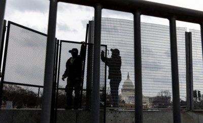 Workers assemble barricades around the US Capitol