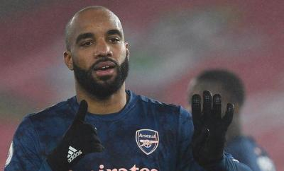 Arsenal striker Alexandre Lacazette signals after scoring against Southampton