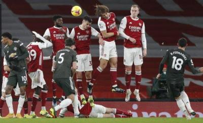 Manchester United's Bruno Fernandes takes a free-kick against Arsenal in the Premier League