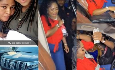 Regina Daniels mum, Rita sheds tears of joy as she receives Prado SUV as birthday present from her daughter (photos/video)