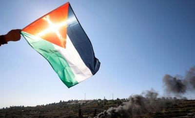 A Palestinian flag over protest near Israeli settlement (file photo)